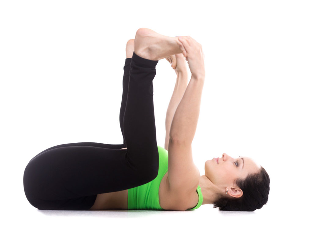 yoga poses for lower back pain, happy baby pose
