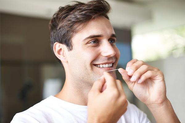 flossing, bad breath, oral health