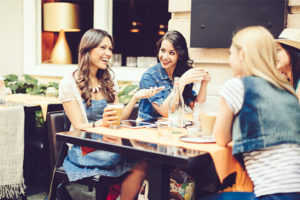 friends talking, gossip, oral health, bad breath