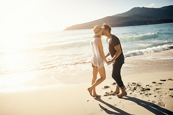 Social media, traveling, couple kissing, beach walk