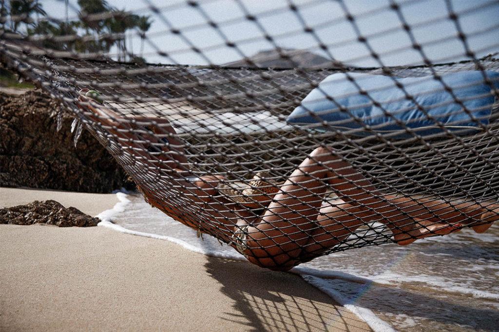 Bianca relaxing on the ocean Hammock