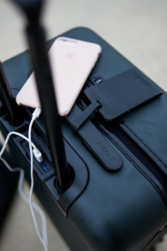 Away luggage with phone charger