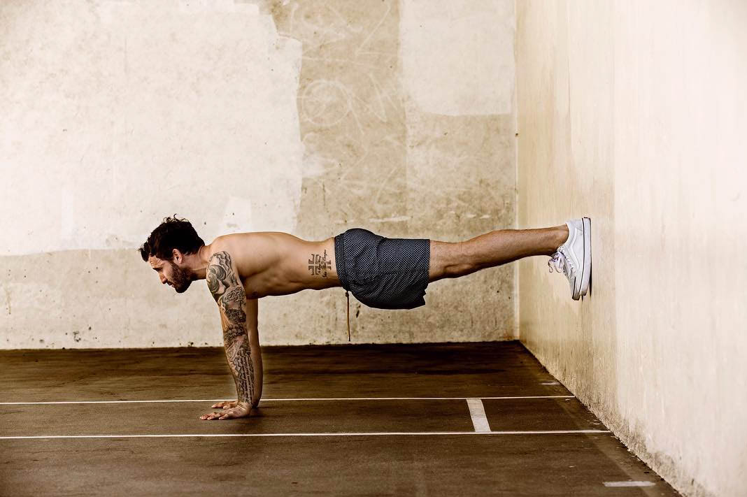 Improved Range Of Motion & Performance—Here's Why More Men Should Be Practicing Yoga