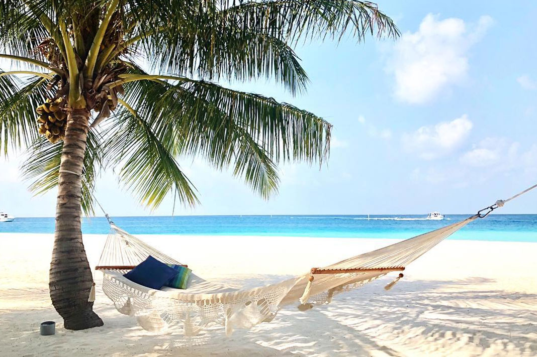 Burnt Out? A Psychologist On Why Escaping To An Exotic Island Is Good For Your Health