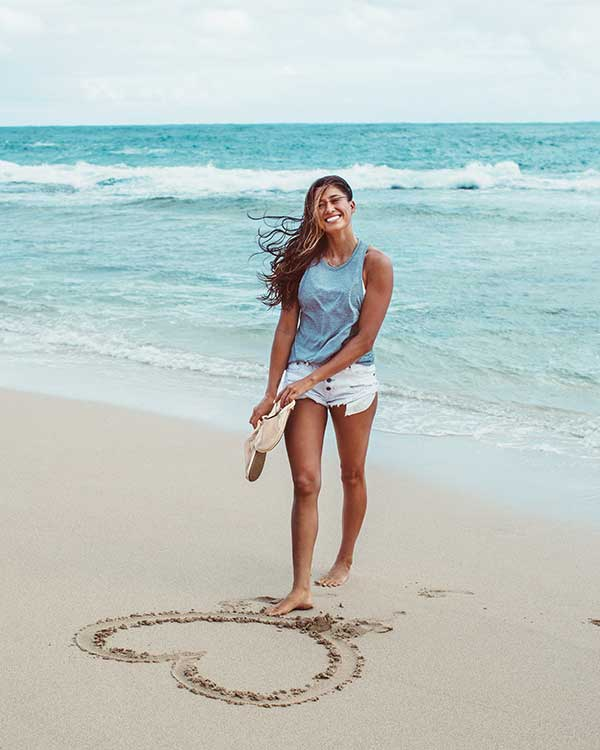 World Renowned Surfer Malia Manuel On Her Love Of Yoga, Fave Surf Spot & Hawaii Lifestyle