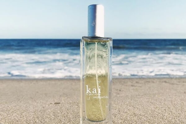 Image of the perfume bottle against an ocean backdrop.
