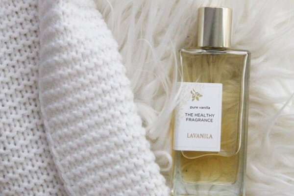 Image of the fragrance on a fluff white rug.