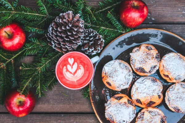 Mince pies surrounded by festive decorations eco-friendly