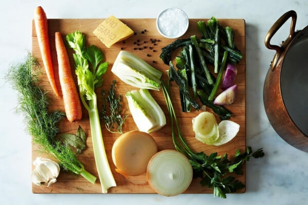 Image of chopped vegetables about to be put in a big pot to make stock.