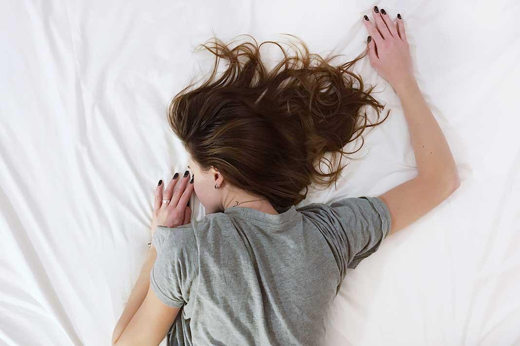 woman bed sleep better