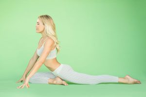 woman doing pigeon pose