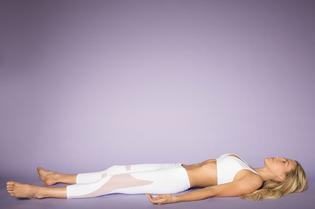 7 Restorative Yoga Poses To Help You Slow Down, Digest & Heal